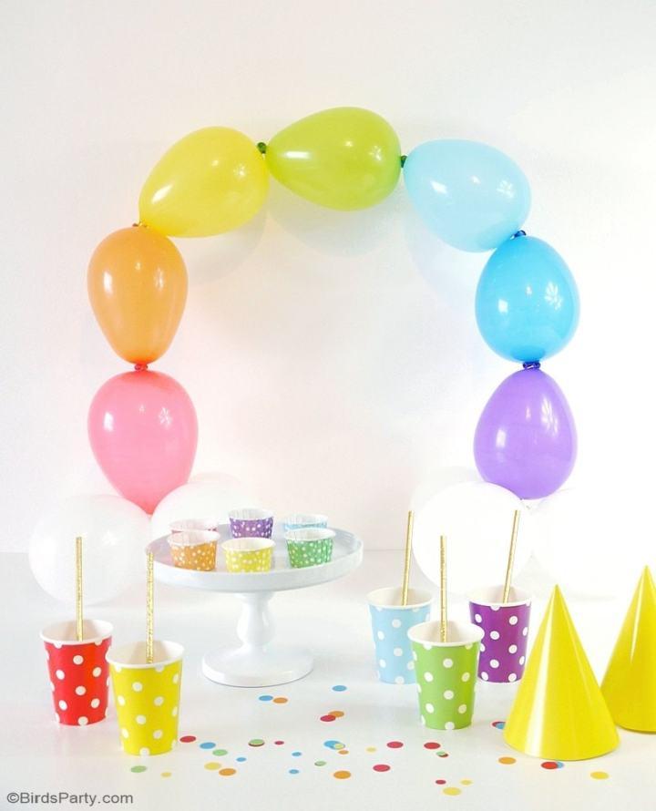 Rainbow party ideas: Simple DIY balloon arch rainbow party decor