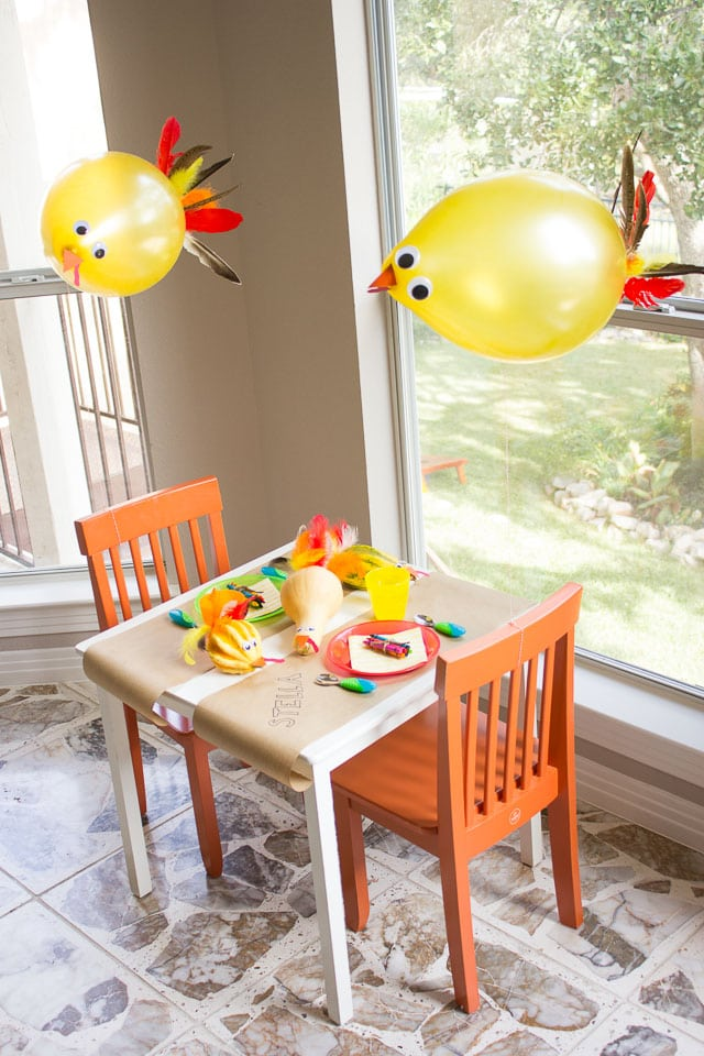 Recreate this Thanksgiving kids table setting, complete with adorable turkey ballons, for a special spot the kids will love.