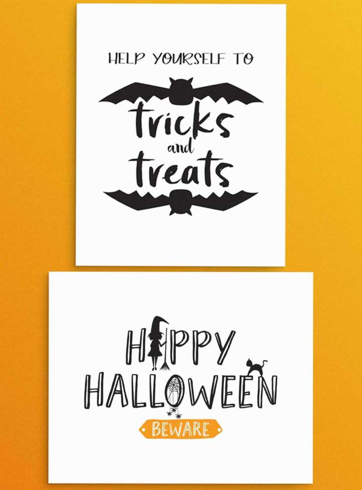 """Free Halloween party printables signs that read, """"Help yourself to Tricks and Treats"""" and """"Happy Halloween - Beware"""". Use for entry way or snack and party favor table. Orange and Black color scheme."""