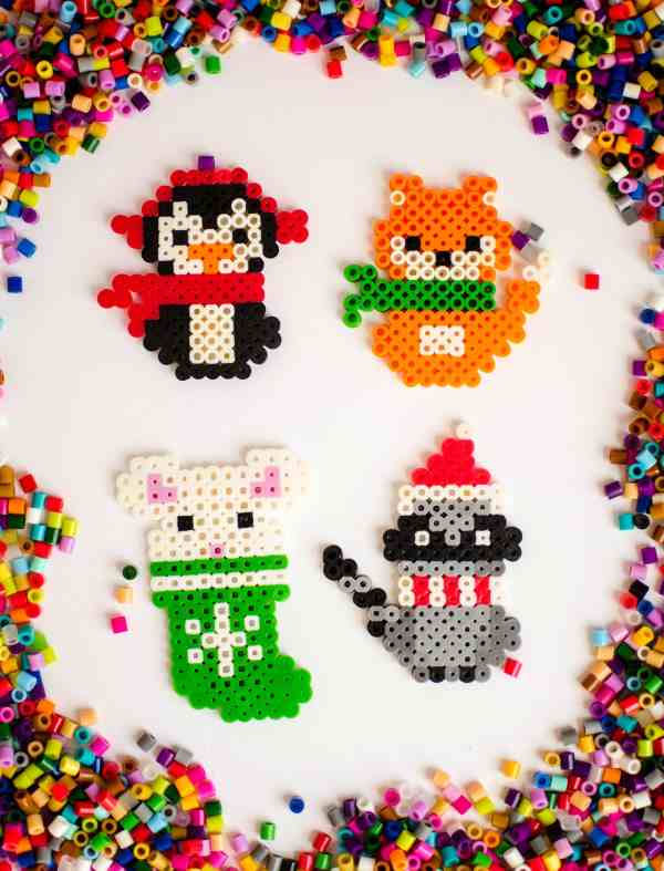 Make these adorable melty bead Christmas ornaments with the free printable patterns available to download. These are so fun to make and are a great kids Christmas craft idea. #ChristmasKidsCraft #MeltyBeads #DIYChristmas