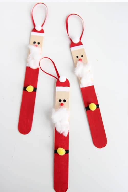 See how to make these adorable popsicle stick Santa ornaments. These are simple to make and super fun for an ornament party and crafting with the kids at home.