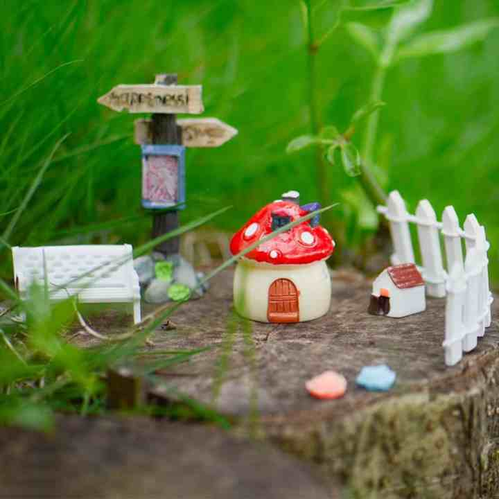 100 piece fairy garden kit with toadstool, fencing, animals, signs.