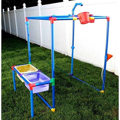 Backyard water park with PVC pipes and bucket.