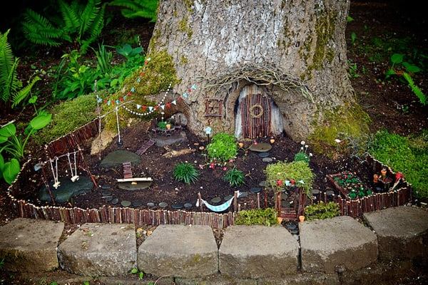 Turn your backyard trees into magical fairy gardens (via The Magic Onions)! This and more amazing backyard play ideas for kids.