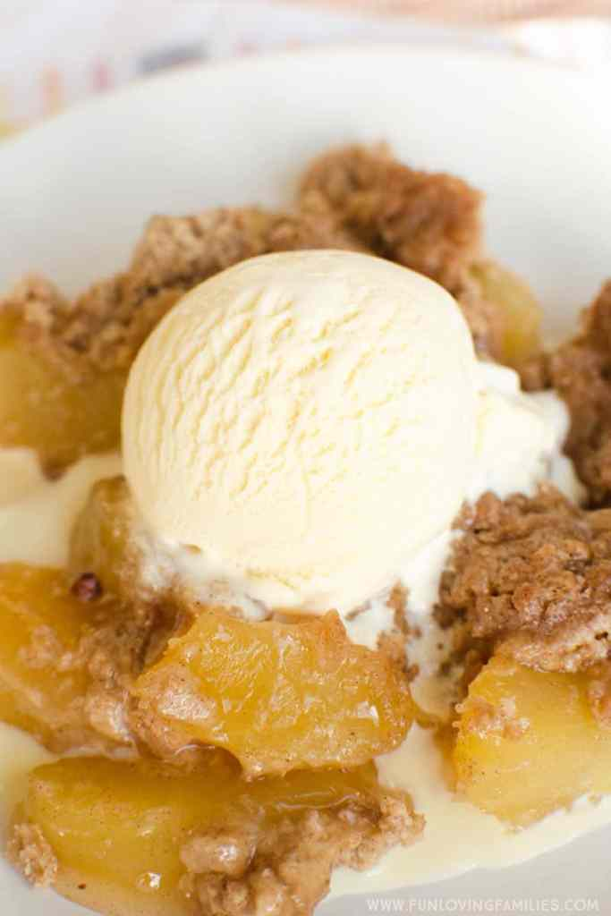 apple spice dump cake with ice cream on top