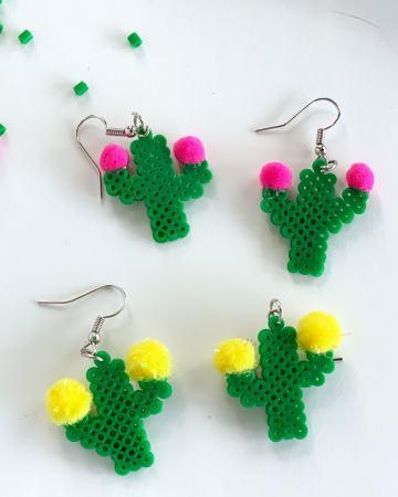 fuse bead earrings shaped like cacti with pom pom flowers
