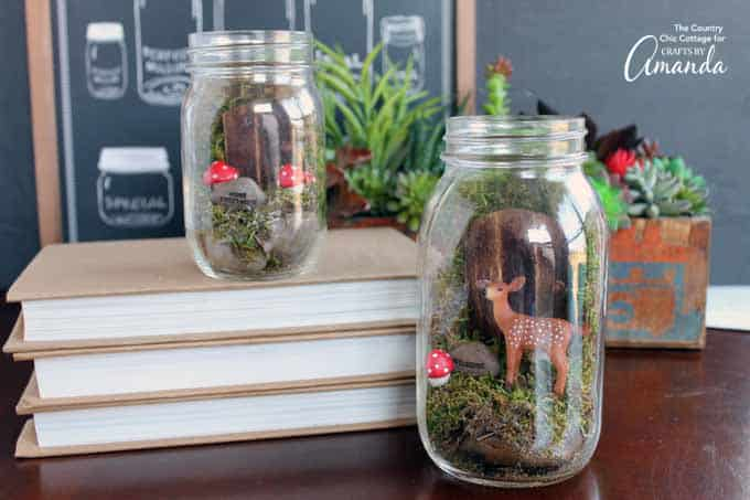 mason jar terrarium fairy gardens with deer and toadstool.