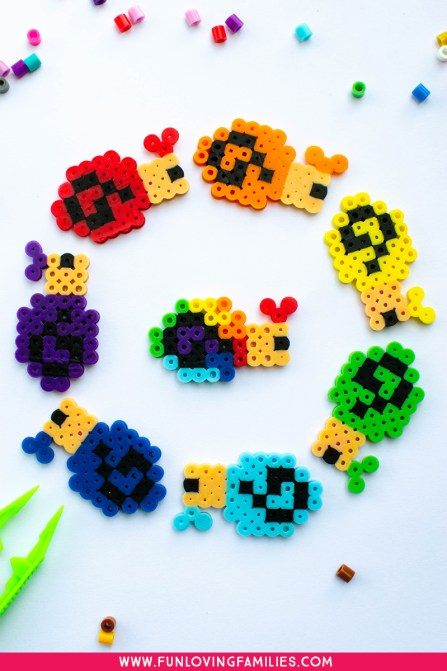 Perler bead craft snails in rainbow colors