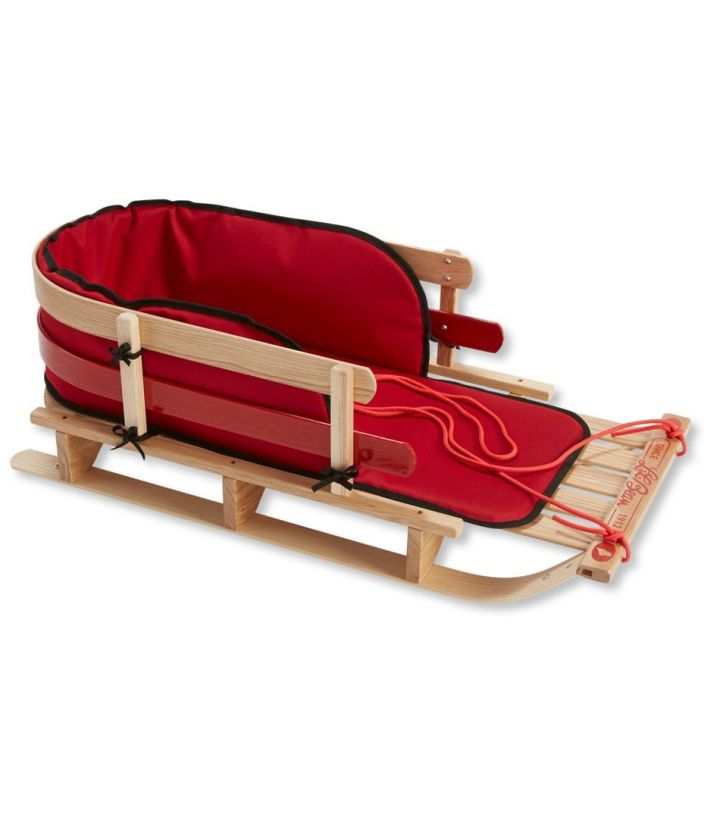 wooden toddler toboggan with red cushion and pull string