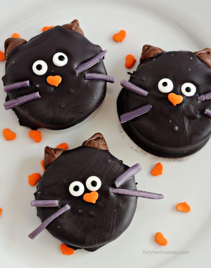 dipped oreo black cat cookies
