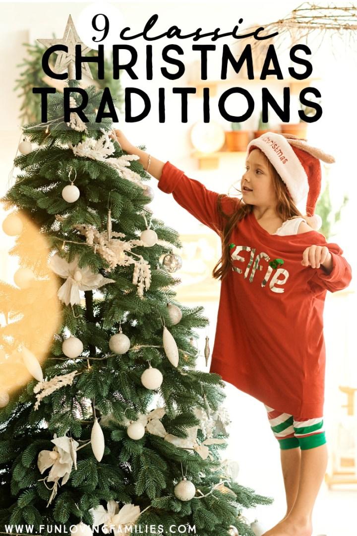 girl adding ornaments to Christmas tree