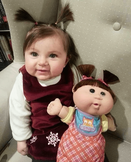 Funny - girl looks just like her doll