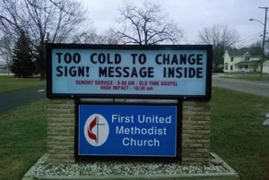 Too cold to change sign - message inside