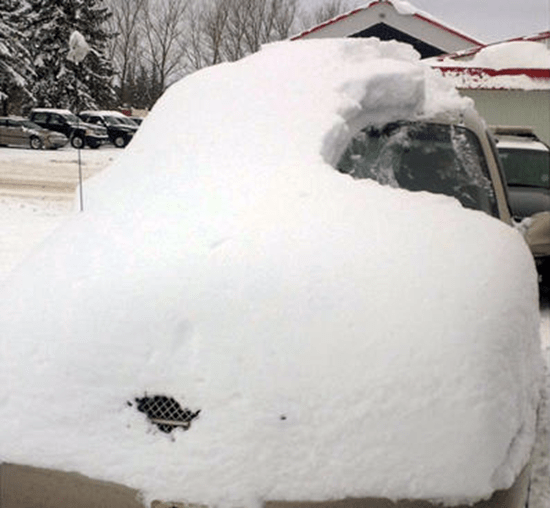 "80-year-old man charged for driving car described as ""pile of snow on road"""