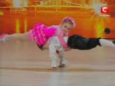 Two children dance in a talent contest and do some amazing acrobats.