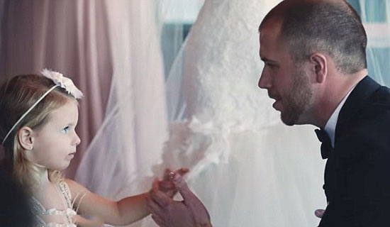During his vows, NASCAR driver Brian Scott suddenly turned to his bride's daughter. And brought everyone to tears.