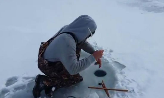 When this guy went ice fishing, he never expected to pull this out of the hole. OMG!