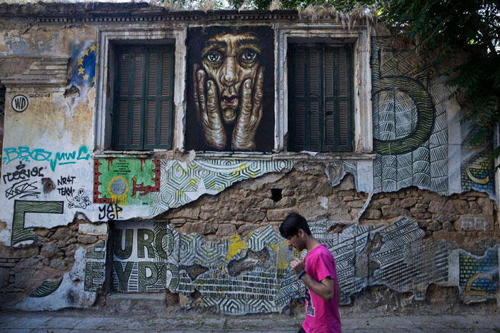 Greece financial crisis - Graffiti artwork titled '5€' by street artist Wild Drawing in Athens