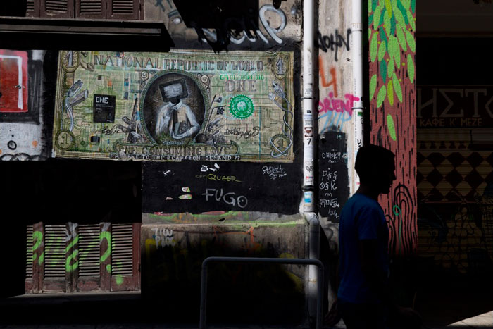 Greece financial crisis - A banknote resembling a U.S. dollar bill by street artist N_Grams in Athens.