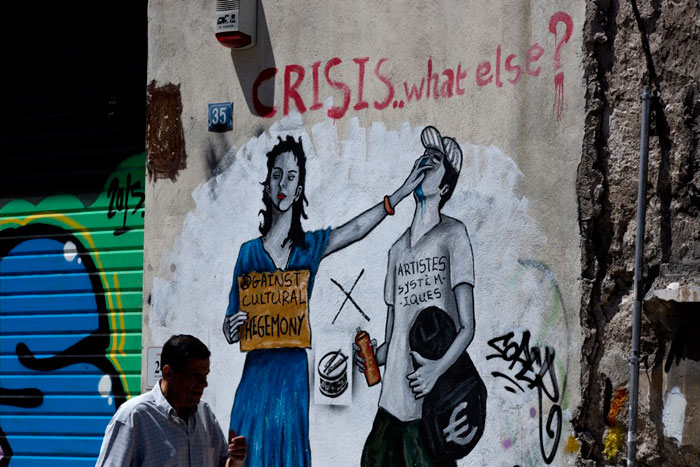Greece financial crisis - 'CRISIS.. what else?' Graffiti work by Greek street artist Bleeps in Athens