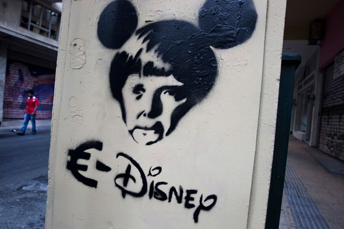 Greece financial crisis - A stencil depicting German Chancellor Angela Merkel as a Disney character in Athens