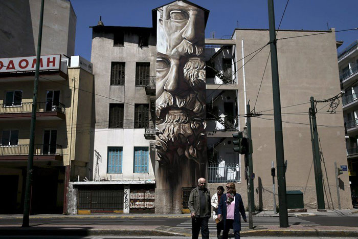 Greece financial crisis - Street artist iNO painted 'System of a Fraud', which shows Solon, founder of Athenian democracy