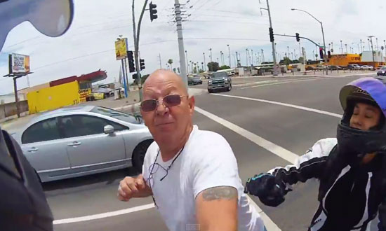 Road rage driver turns violent and assaults motorcyclist. He regrets it immediately!