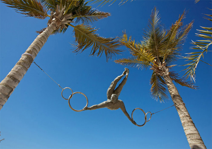Circus Act Between Coconut Tree Sculpture by Jerzy Kedziora