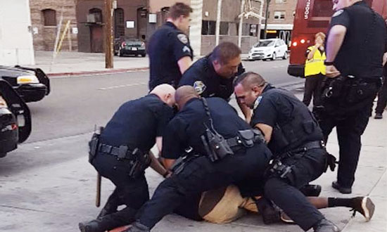 Watch How 9 California Cops Beating And Arresting Crying Black Teen 'For Jaywalking'