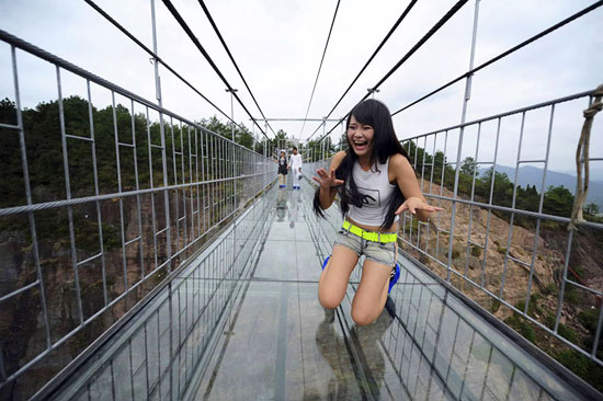 World's Longest Glass Bridge Opened in China and Tourists Are Terrified to Walk on It!