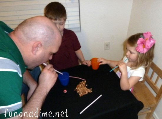 Fun Family Games for young kids. Bean and straw game variation from our popular M&M game