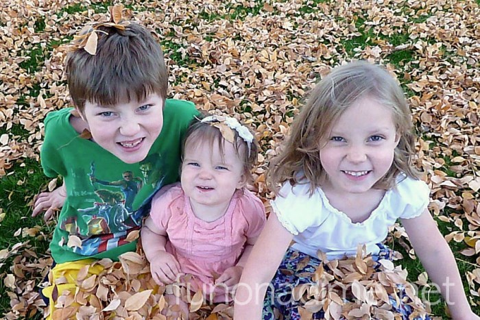Leaf pic with kids 2013 How To travel On a Dime - leaf family pic
