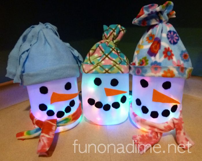 Milk and/or Vinegar Jug Snowman Lantern Kid Made Snowman Lantern - Recycle Art  - Super easy and we used what we had on hand…milk jugs, scrap fabric, duct tape (more kid friendly than a hot glue gun). They love them!