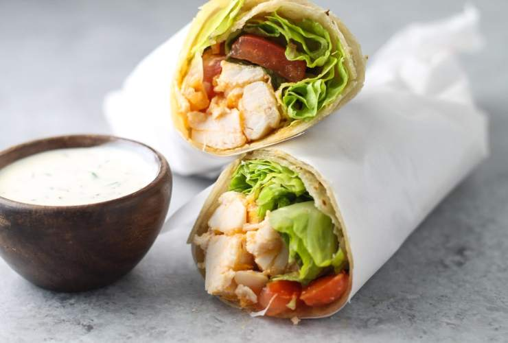 Looking for a quick and flavorful lunch?! Try this Low Fodmap Buffalo Chicken Wrap recipe! It's also gluten free and easily made dairy free!
