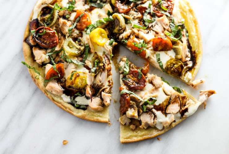 Transform the classic appetizer into a mealtime favorite with this Low Fodmap Bruschetta PIzza with Chicken. Gluten free and full of flavor, this will quickly become a family-favorite recipe!