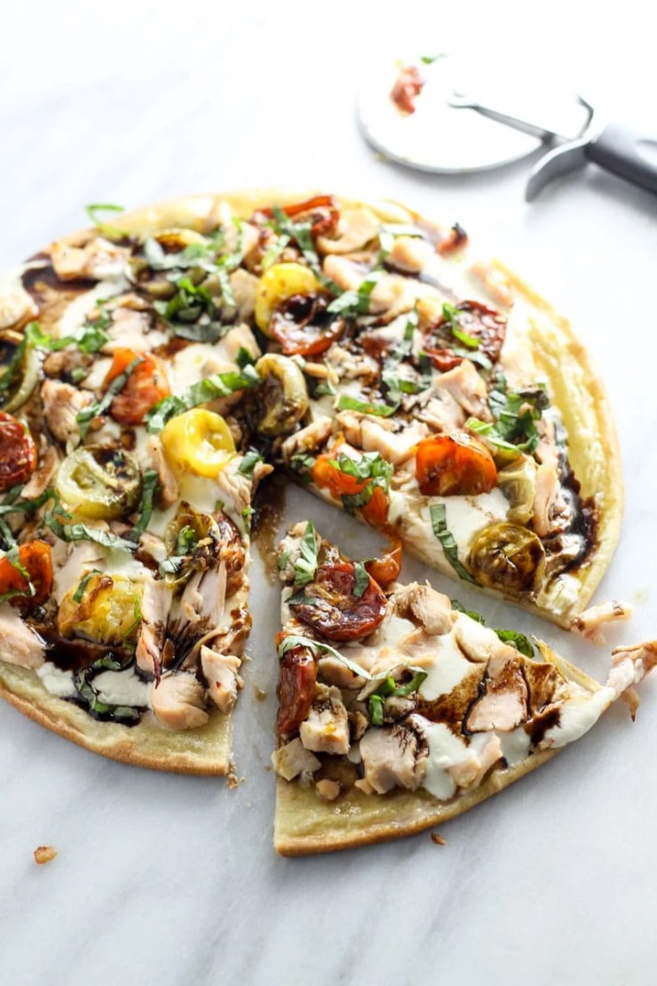 Transform the classic appetizer into a mealtime favorite with this Low Fodmap Bruschetta PIzza with Chicken. Gluten free and full of flavor, this will quickly become a go-to recipe!