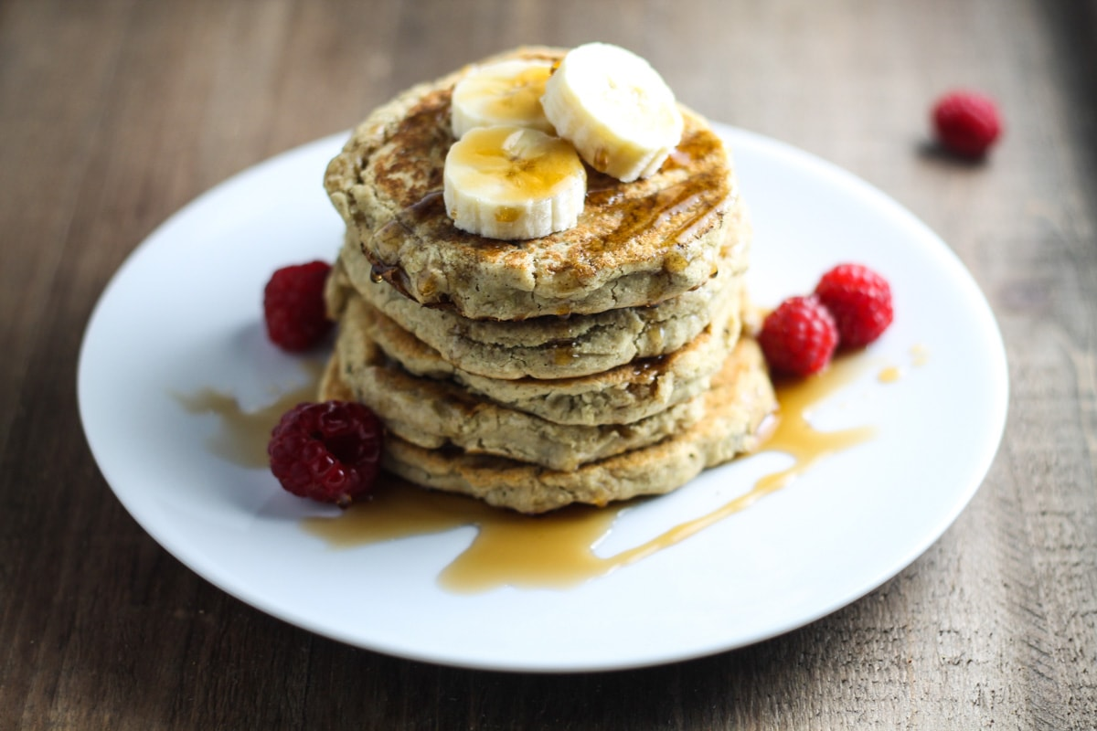With only a handful of ingredients, these Low Fodmap Pancakes with Raspberries and Bananas is perfect for a quick and nutritious breakfast!
