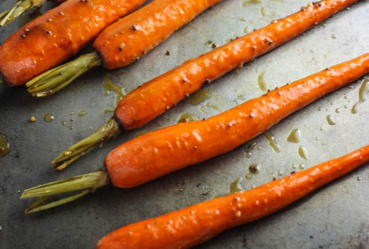 These colorful, roasted Low Fodmap Maple Dijon Carrots look elegant, but are easy enough for a weeknight side dish! They're also gluten free and dairy free!