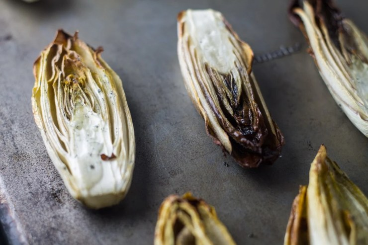 Never tried endive? Try my Low Fodmap Roasted Endive! The result - just tender-crisp and caramelized with a hint of sweetness. Gluten free and dairy free deliciousness!