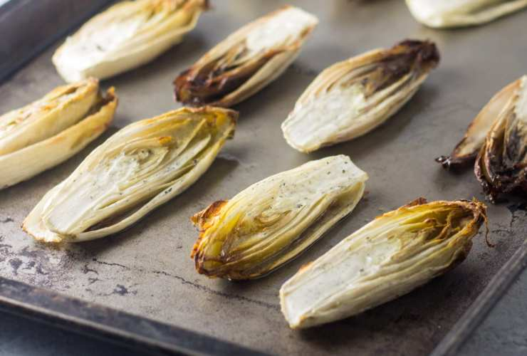 Tender-crisp and just caramelized these Low Fodmap Roasted Endive pair perfectly with baked chicken or pork chops. They're also gluten free and whole30-friendly!