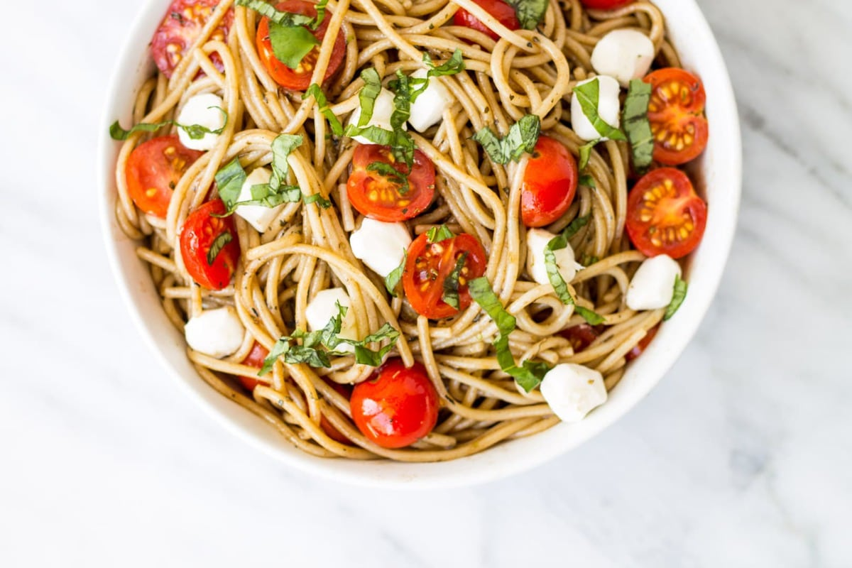 Whole grain gluten free pasta meets fresh and flavorful ingredients in this quick and easy Low Fodmap Caprese Pasta Salad.