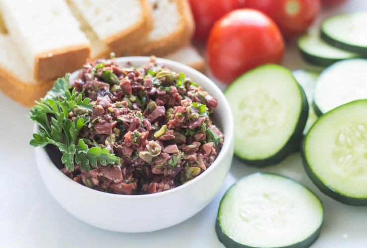 This Low Fodmap Olive Tapenade recipe is a satisfying and scrumptious spread for low fodmap bread, veggies, fish and more!  Paleo, vegetarian, gluten free and whole30 friendly.