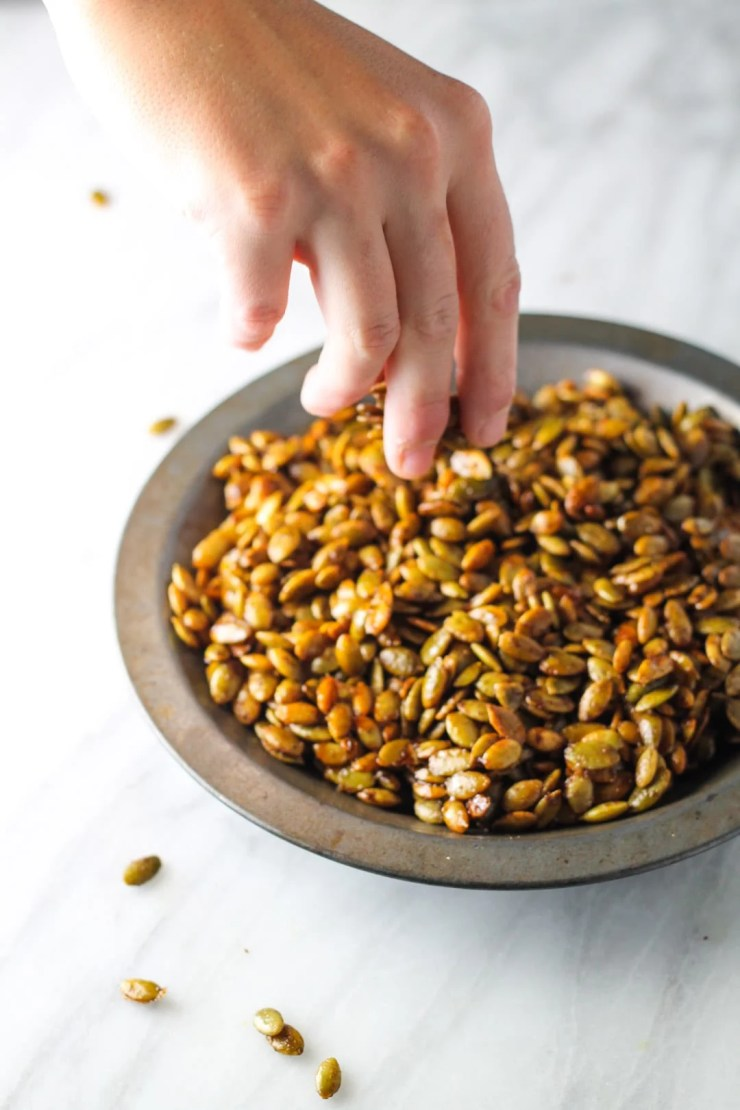 Sweet, crunchy and fall-flavored, these Low FODMAP Pumpkin Pie Spiced Pumpkin Seeds are hard to put down! Try them for a yummy sweet treat or snack!