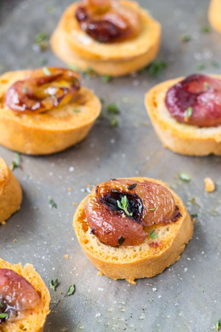A delicious combination of sweet and savory, make this Low FODMAP Crostini with Roasted Grapes and Thyme for a crowd-pleasing appetizer.