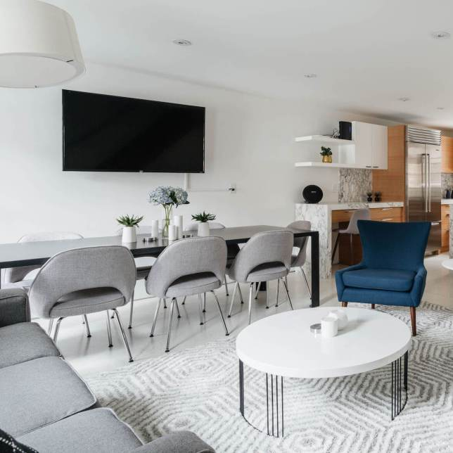 Open living dining room with white walls