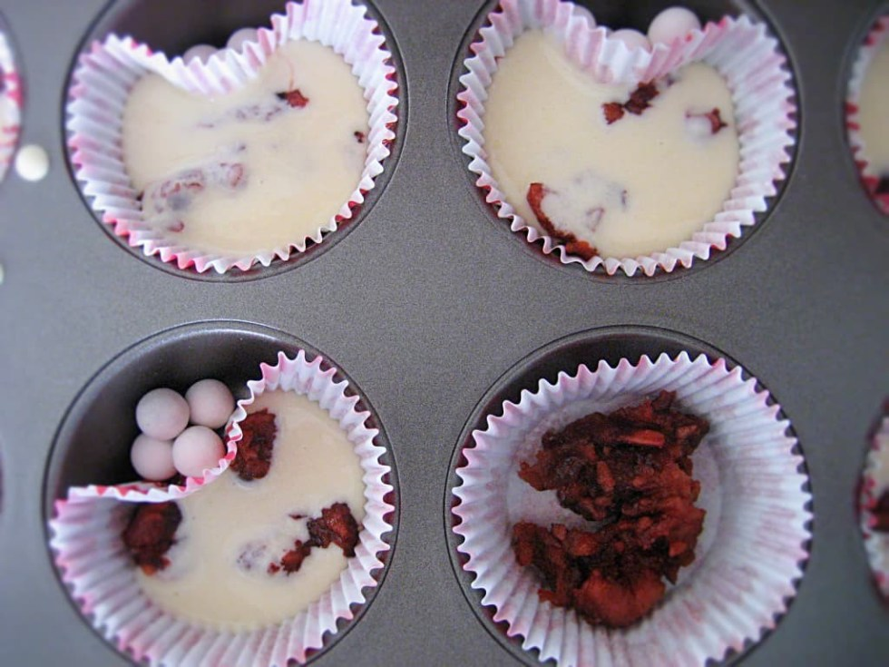 No need for heart-shaped cupcake molds, just use marbles or pie weights!