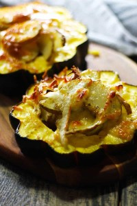 Janssons Temptation with Acorn Squash. A traditional Swedish smorgasbord potato side that is made during special occasions. Flavored with onions and anchovies, this version is served inside acorn squash and topped with Gruyere. This dish is AMAZING!! Both easy and delicious with multiple layers of flavor. Make this for your next potluck! | FusionCraftiness.com