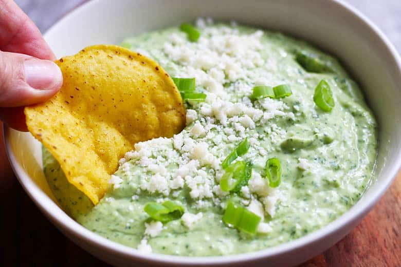 Creamy Jalapeno & Avocado Salsa. A fresh and creamy salsa with some bite. Great for chips, tacos, fish and chicken. Can be used as a veggie dip too! This vegetarian salsa is easy and fast in a food processor. | FusionCraftiness.com