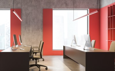 Side view of modern consulting company office in loft style with red and concrete walls, long gray computer tables and bookcase with folders. 3d rendering