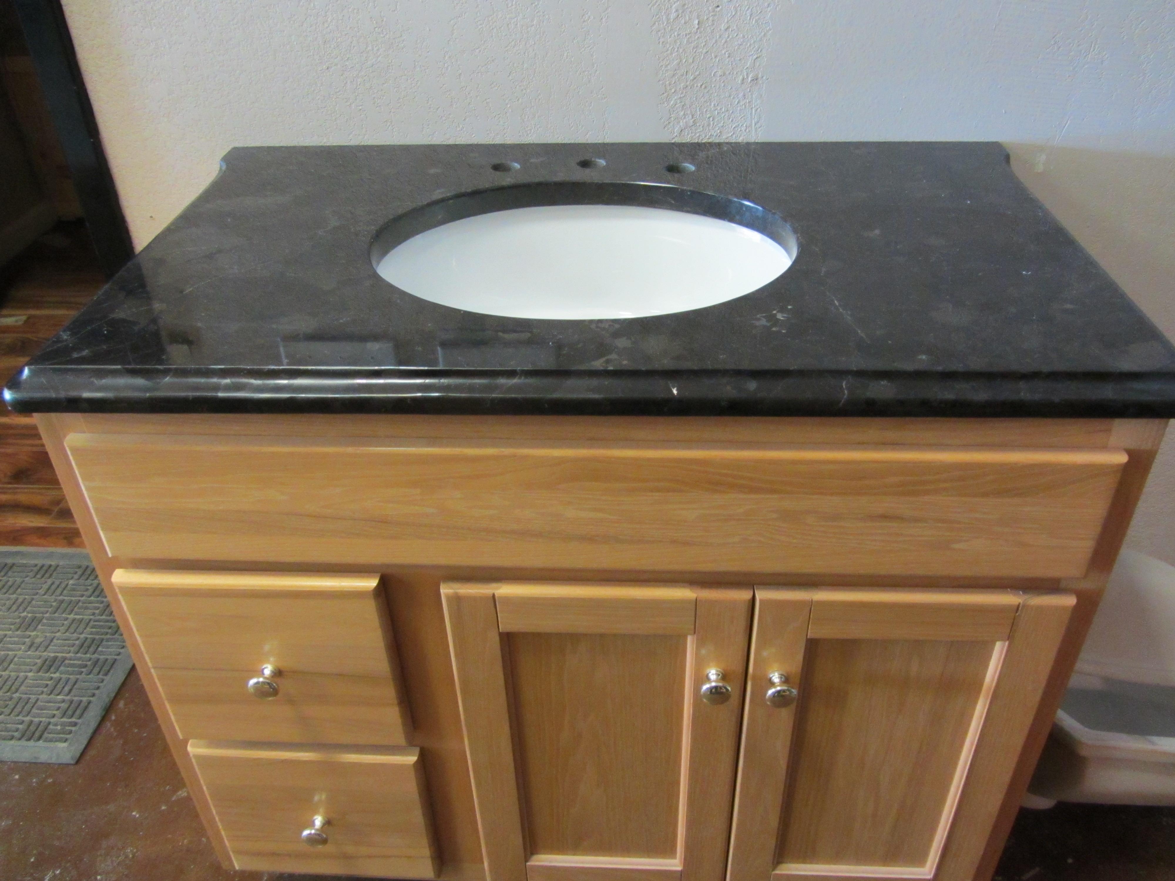 bathrooms with a granite vanity top